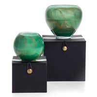 Swirls of gold and green highlight blown-glass, hand-poured Esque candles packaged in a black satin gift box. $19.95 and $34.95 at Z Gallerie, all locations, and zgallerie.com.