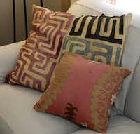 Vintage textiles accent a neutral sofa.