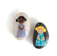 To create story stones, glue paper dolls to stones and seal them with Mod Podge.
