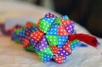 Each of the girls' origami ornaments takes several hours to complete and is made in the traditional Japanese style.