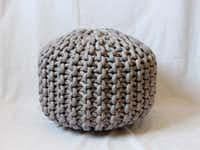 MADE BY HAND: Etsy artisan Cara Corey of MaryMarieKnits uses extra-large knitting needles and white cotton rope (dyed a range of colors) to handcraft poufs before stuffing with a sturdy foam. Her extra-large model, 18 inches in diameter by 14 inches tall, runs $228 at etsy.com.