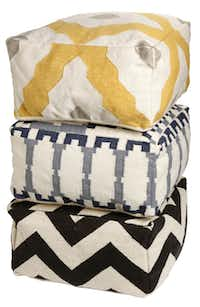 MADE BY HAND: The Bazaar Dhurrie pouf (top), Kew Dhurrie (center) and Zigzag Dhurrie are made through a collaboration with Craftmark, a nonprofit that helps artisans in India's rural villages earn a living. The poufs, in various dimensions, are made from traditional flat-weave dhurrie rugs. $249 each at West Elm, Dallas, and westelm.com.