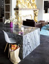 A custom crafted table made of Silver Wave marble pairs nicely with classic modern furnishings.(Allied Stone - Allied Stone)