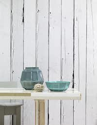 Taking a cue from Piet Hein Eek's realistic Scrapwood designs, at left, the Wallpaper Collective has introduced selections that replicate weathered concrete surfaces and antique embossed tin ceiling tiles.
