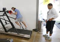 David Vobora,  owner of Performance Vault, hops on a treadmill to show James Castleman, a defensive lineman at Oklahoma State University, how to adjust his running technique. Word of warning: The treadmills at this gym aren't like any old treadmill.(Vernon Bryant - Staff Photographer)