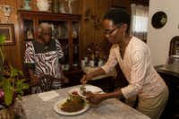 Re Richardson, a member of Black Vegetarian Society of Texas, prepared a vegan meal of quinoa and sauteed vegetables recently. Her mother, James Watson (left), respects and admires her daughter's resolve, but hasn't fully embraced the vegan lifestyle.