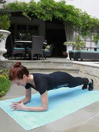 """Krisitin Moses of BodyBar shows the technique for """"The Plank""""  part of the routine for a 20-minute workout on Monday, April 02, 2012."""