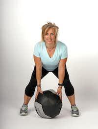 Spoonts demonstrates med-ball slam( Lara Solt  -  Staff Photographer )