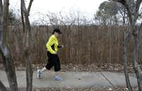 Lisa Taylor walks around her Flower Mound neighborhood for an exercising early morning on February 7, 2013.