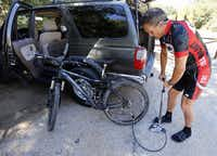 Todd Codish airs up his mountain bike tires before a ride at Murrell Park in Flower Mound. Several doctors opted out of doing the extensive surgery that Codish needed for his back.