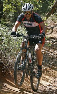 TriathleteTodd Codish, 51, rides the trails at Murrell Park in Flower Mound. Codish underwent extensive back surgery in October 2011 and was cleared to train without any limits last year.