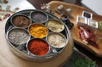 The ayurveda spices of life are turmeric, whole mustard seeds, roasted cumin seed powder, dry mango powder, red chili powder, coriander seed powder and whole cumin seeds.Lara Solt - Staff Photographer