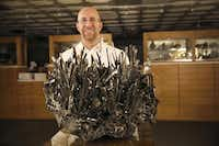 Rob Lavinsky displays stibnite from China, a mineral with a metallic luster, at the Arkenstone, open only by appointment.Andy Jacobsohn - Staff Photographer