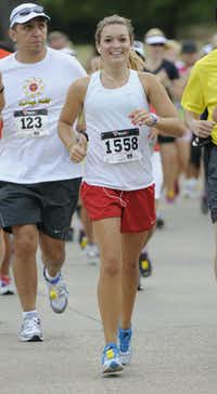 Emily Mullins smiles as she begins the Hottest Half at Norbuck Park on Sunday, August 12, 2012(Rex C. Curry)