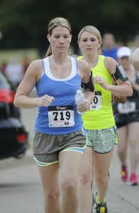 Brooke Cowart concentrates as she runs the Hottest Half at Norbuck Park on Sunday, August 12, 2012(Rex C. Curry)
