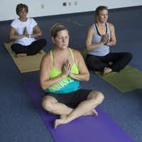 """Scholberg decided to try yoga when her company offered classes twice a week. """"Because of my mentality, I really like the physical challenges,"""" she says. """"It's still hard for me, and I've been doing it almost four years."""""""