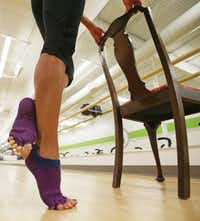 McStay demonstrates the heel lift recommended by Lindberg as a simple but effective exercise.