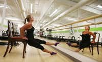 """Kerry McStay demonstrate """"bare-bones workouts"""" utilizing just an ordinary chair, especially good for people with financial, transportation, health, safety issues, at Studio 6 off of Preston Road and Forest Lane on Monday, October 14, 2013."""