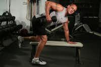 """The one-armed row works mainly the upper back. The bicep is what David Whitefield calls """"the helper."""""""