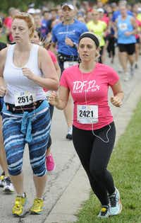 Buffie Campbell, left, and Amanda Holdbrook begin the the 10k race of the Tour des Fleurs behind the Dallas Arboretum on Saturday, Sep. 15, 2012.