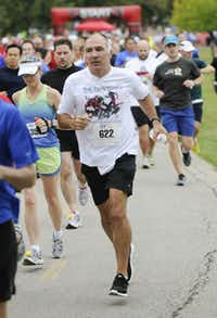 James Rose begins the the 10k race of the Tour des Fleurs behind the Dallas Arboretum on Saturday, Sep. 15, 2012.