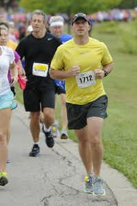 David Cusey begins the the 10k race of the Tour des Fleurs behind the Dallas Arboretum on Saturday, Sep. 15, 2012.