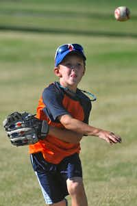 Tristan Biggs, 7, practices baseball fielding at Bacchus Park in Frisco on recently. Biggs has Type 1 diabetes and is mentored by former pro baseball player Drew Holder, who also has Type 1 diabetes.