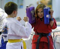 """Diane Reeve (with Maddock Steeger, 11) continues to teach at the martial arts studio she owns in Plano. She was diagnosed with AIDS in 2007. """"I teach courage for a living. I have to live what I teach."""""""