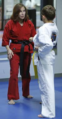 Diane Reeve (left) of Plano gives instruction at her martial arts center, Vision Martial Arts Center in Plano on Thursday, October 17, 2013.