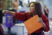 Diane Reeve of Plano gives instruction at her martial arts center, Vision Martial Arts Center in Plano on Thursday, October 17, 2013.