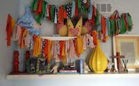 The fabric banner hanging in the nursery was made by a friend for Mack's baby shower. Giddens sewed the stuffed foxes on the shelf for his first Christmas.Lara Solt - Staff Photographer
