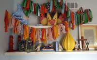 The fabric banner hanging in the nursery was made by a friend for Mack's baby shower. Giddens sewed the stuffed foxes on the shelf for his first Christmas.(Lara Solt - Staff Photographer)