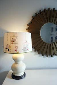 The lampshade from Anthropologie, a wedding gift, has been transferred to the nursery.( Lara Solt  -  Staff Photographer )