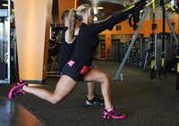 Nicole Petrick, 24, works out her lower body on Oct. 20, 2011 at Just Fitness in Carrollton, Texas. Ben Torres/Special Contributor