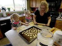 Maddie Dittlinger, 3, and her twin sister Izzie (center) helped their mother Amanda (right) make crackers at their home in Wylie on Wednesday, April 20, 2011.  (Stewart F. House/Special Contributor)