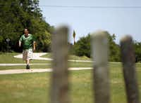 Jesus Chairez walked recently on the Santa Fe Trail in East Dallas. Chairez has lost 15 pounds since March.