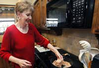 "At home in Lucas, Carrie Brazeal prepares Tuscan chicken. ""People diagnosed with diabetes can eat just about what they want to,"" she says. ""Just not as often and maybe not as much as they like."""