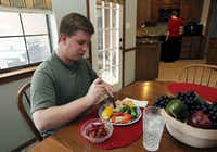 Craig Brazeal, 23, of Lucas enjoys the Tuscan chicken meal made by his mom, Carrie Brazeal, who leads a cooking class for Type 2 diabetics.