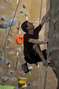 Tadd Jensen of Dallas scales a wall during a climbing session at Exposure Indoor Rock Climbing in Carrollton.