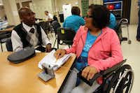 Former patient Justin White, 27, speaks with stroke patient Melly Walsh about his rehab experiences at the Baylor Institute for Rehabilitation.