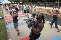 Camp Gladiator participants pump weights as hard as they can for 20 seconds, then ease off for 10 seconds in a four-minute routine.