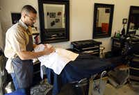 """Barber Troy King, shown shaving David Godsey of Dallas, says, """"A good after-shave is worth its weight in gold."""""""