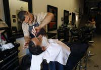 Dallas resident David Godsey gets a hot-lather straight-razor shave from barber Troy King.