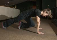 Kim Williams, a trainer at Baylor's Tom Landry Fitness Center demonstrates mountain climbers.