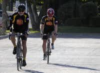 Ford Baker, left, completes his bike ride from his Carrollton home to his to his Dallas office near the Baylor hospital with training mentor and friend Doug Walker.