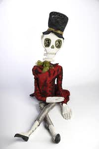 Dressed to kill : Crafted of stuffed, satin fabric and sporting a glittery top hat, Harold the skeleton looks surprised that he might frighten anyone. Designed by artist Joe Spencer. 60 inches high. $187.50 at Dougherty Pharmacy, Preston Royal and Forest Park. Photographed at DMN studio in Dallas, TX on September 27, 2013.