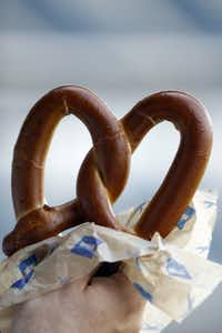 EAT THIS: A soft pretzel is a healthier option when compared to nachos, French fries and even popcorn. The pretzel has 360 calories and 2 grams of fat. Ordering the unsalted version will make it more heart healthy, dropping sodium from 2220 mg to 300 mg. To add flavor,  dip the pretzel in a mustard, which is naturally low in calories.