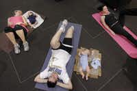 Working out indoors, protected from the sun, (From left) Kristin Stanley, Krystal Hurst, and Cody King, keep their children at their side while they workout with Baby Bootcamp, a program designed to help post-pregnancy mothers regain pre-pregnancy fitness, at Galleria Dallas shopping mall in Dallas.