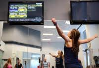 "Chaney watches as her numbers and activity show up on the monitor via the My Zone strap. Studio owner Stephanie Hanson says the system ""helps people work out harder, be more accountable.""(Michael Mulvey - Special Contributor)"