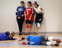 From Left, Julie Johnson, 45, of garland, Libby Daugherty, 15, of Mesquite, and Anna Martinez, 15, of Plano, talk about the game along the back court wall at the Bradfield Recreation Center in Garland recently.  Blind and visually impaired athletes play goalball and enjoy the same attribute of sport as non visually challenged athletes.